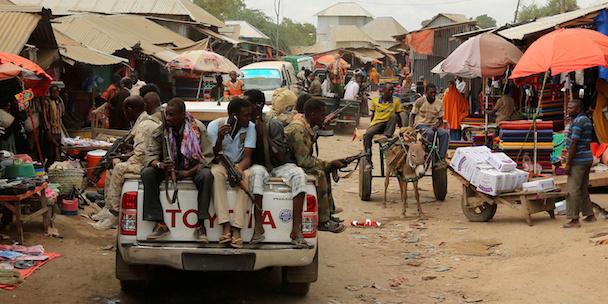 Somali soldiers patrol a street market