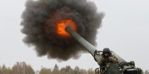 A Ukrainian serviceman fires a 2S7 Pion self-propelled