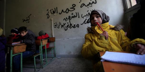 Children attend a classroom in Aleppo